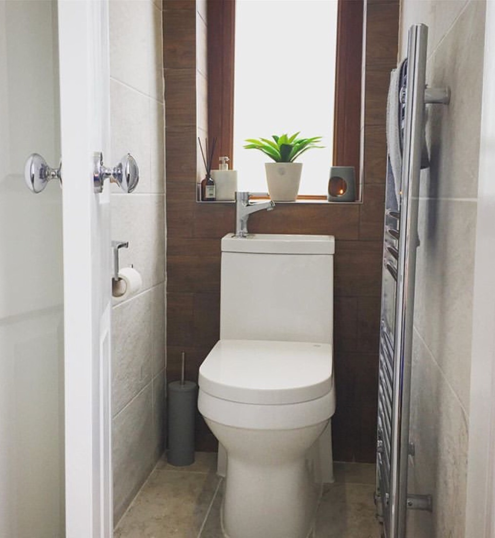 toilet with sink on top