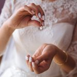 Earring in the hands of the bride