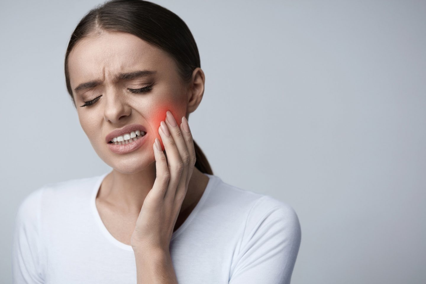 Tooth Pain And Dentistry. Beautiful Young Woman Suffering From Terrible Strong Teeth Pain, Touching Cheek With Hand. Female Feeling Painful Toothache. Dental Care And Health Concept. High Resolution