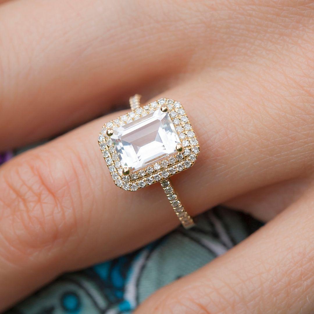 enagement ring on woman's finger