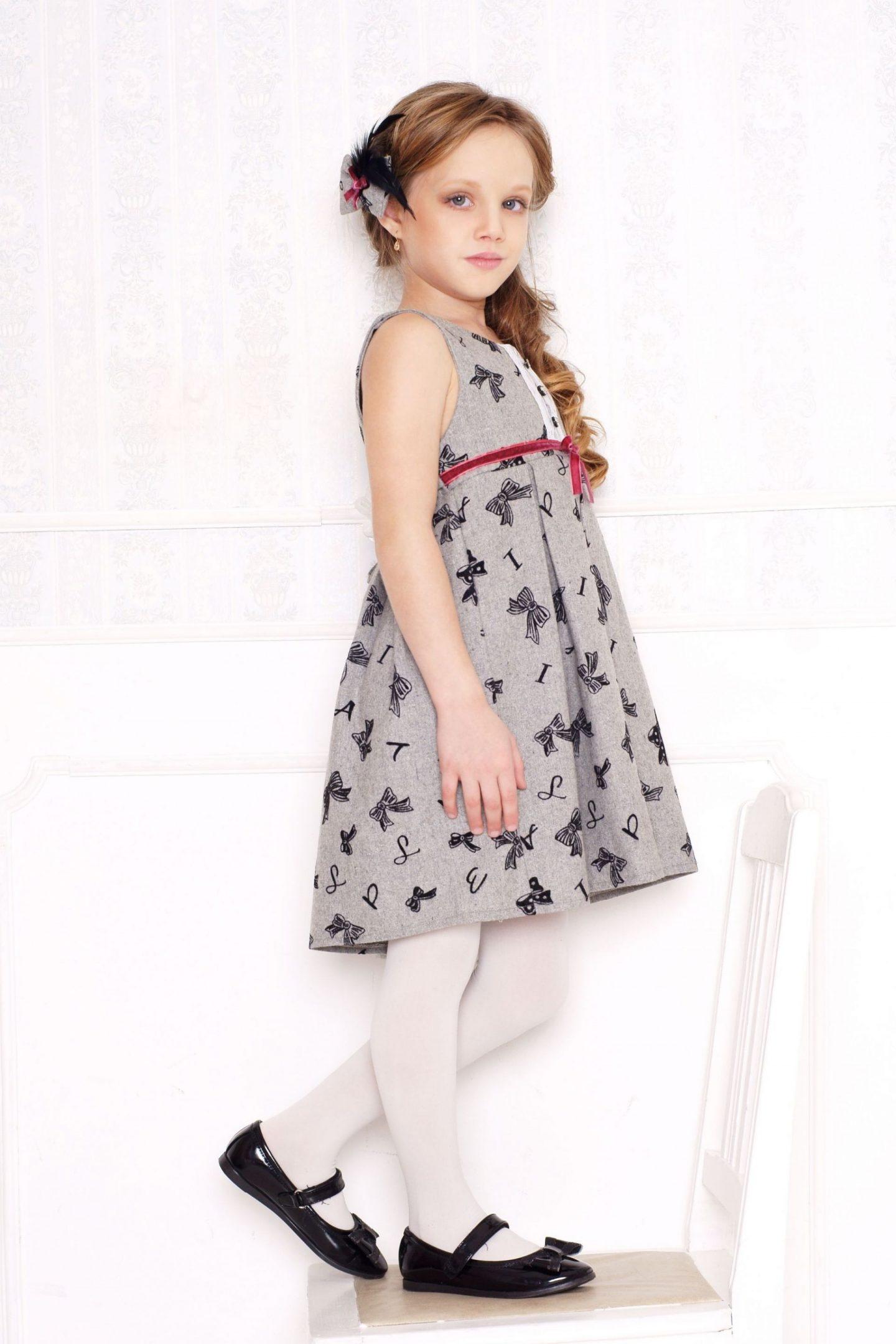 little girl in grey dress and white leggings