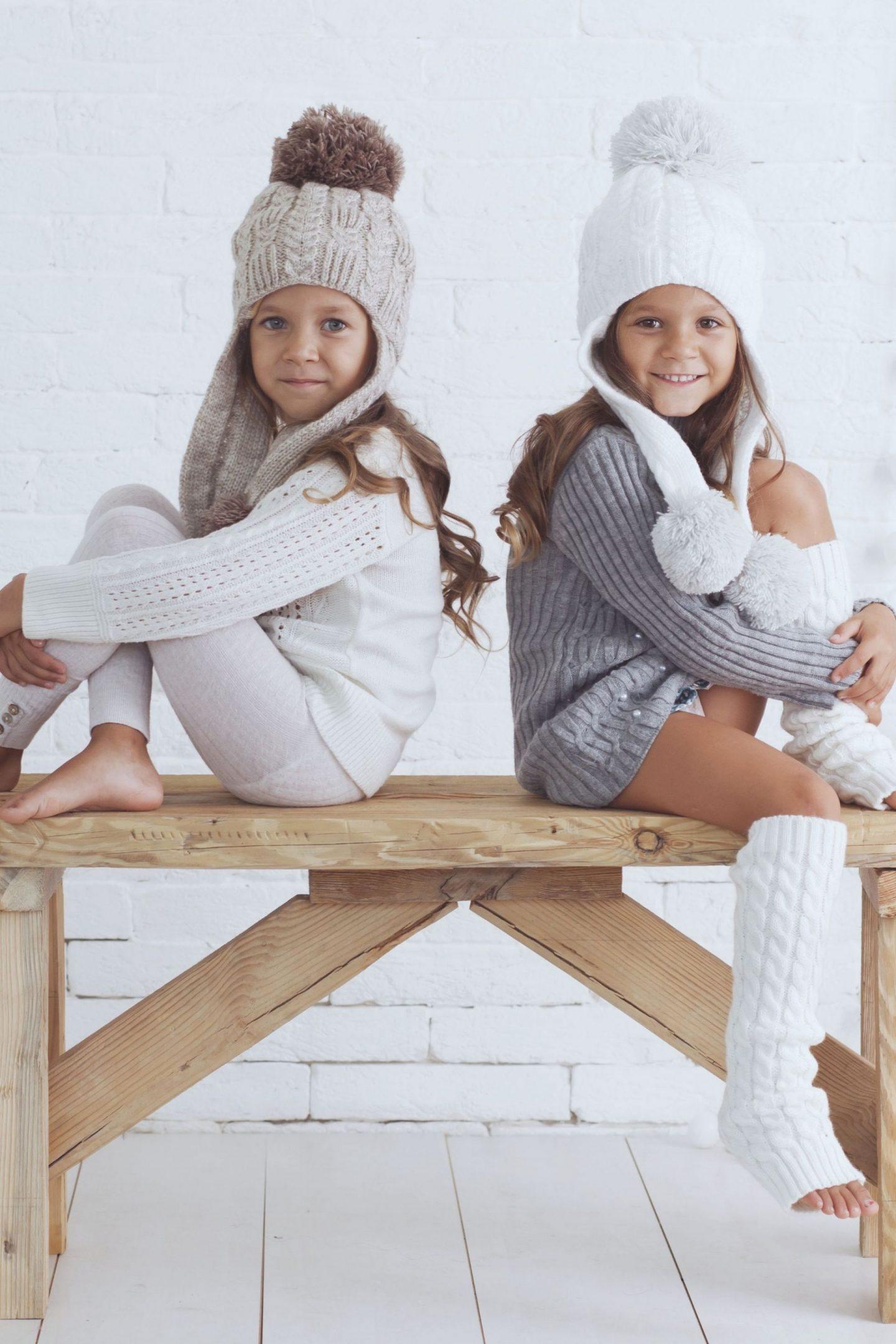 little girls in long-sleeved sweaters