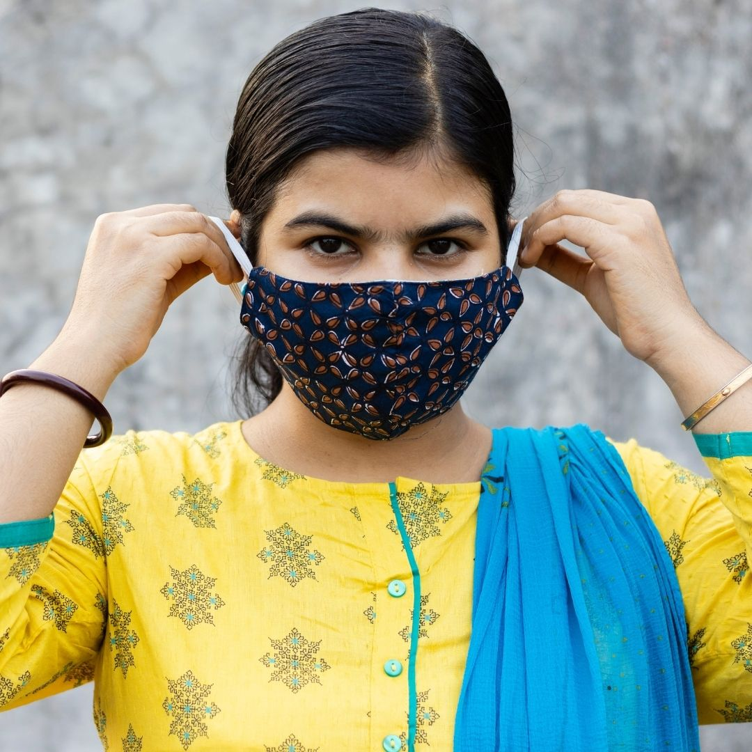woman wearing fabric nose mask for protection against coronavirus