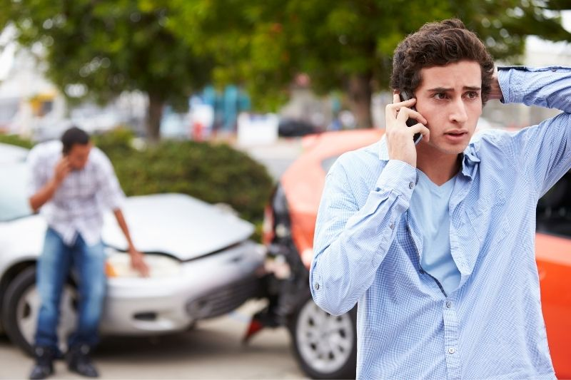 driver making a phone call after a ca accident