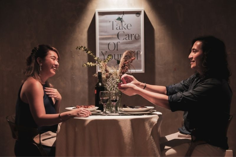 romantic couple engagement at dinner