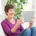 woman on a video call using tablet