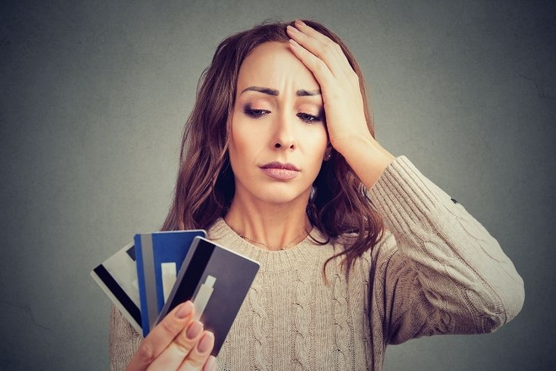 desperate woman having loan credit card problems