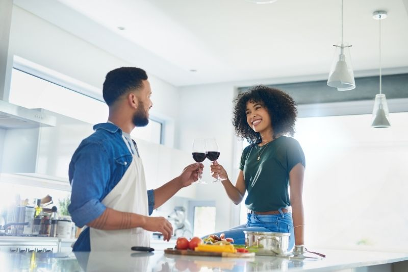 couple making dinner at home for date night