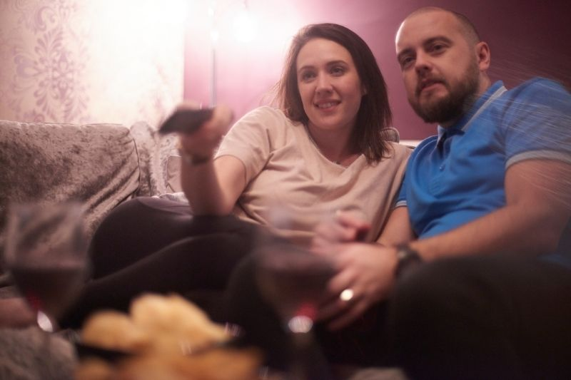 couple watching Tv at home for date night