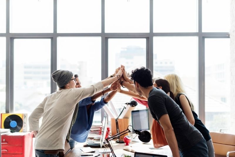 teamwork power - successful meeting at the workplace concept