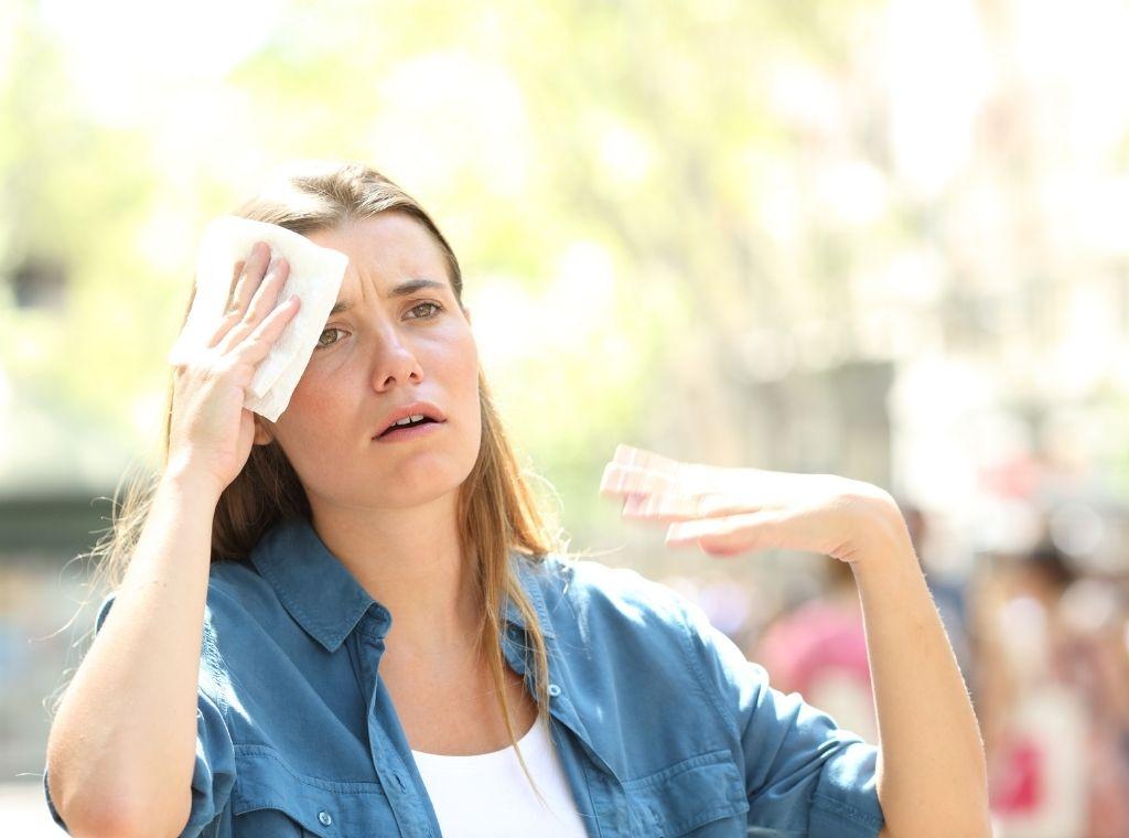 unhappy woman suffering from heat stroke