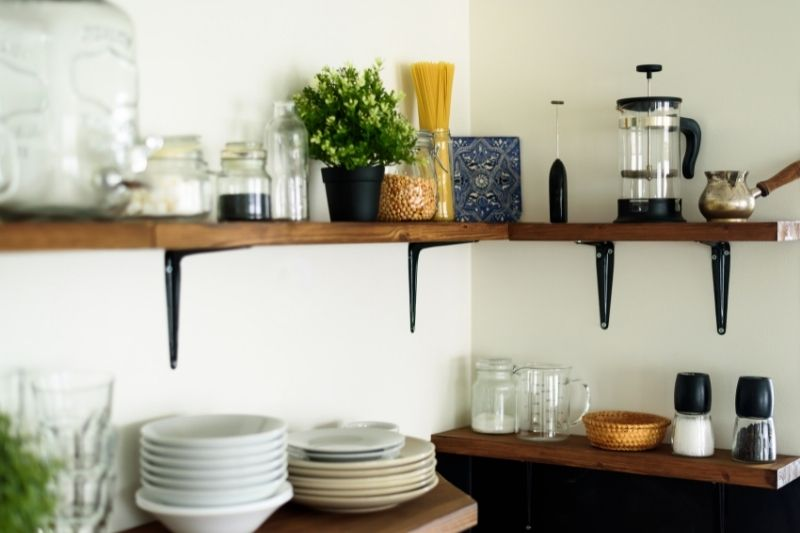 dish on open shelves in the kitchen