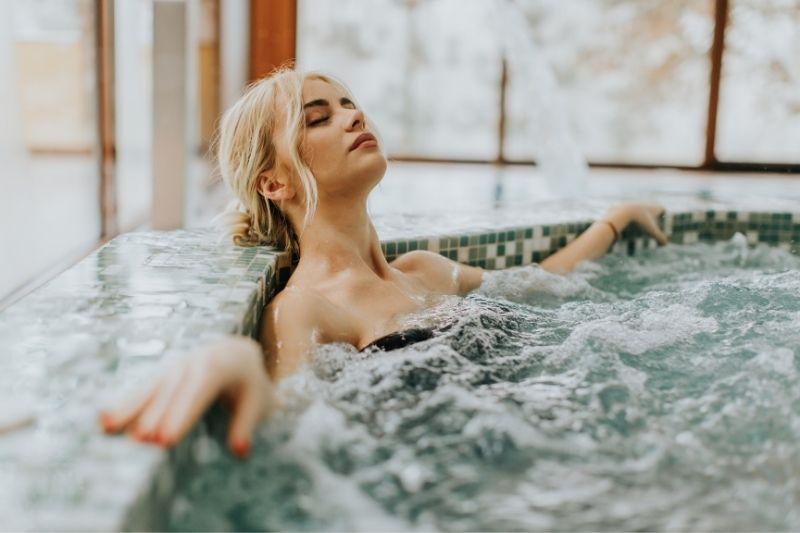 woman relaxing in a whirlpool bathtub