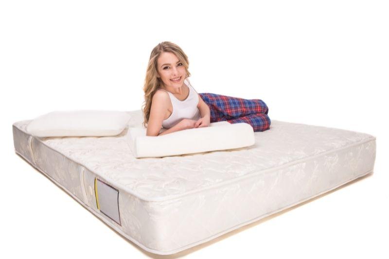 woman lying on a mattress