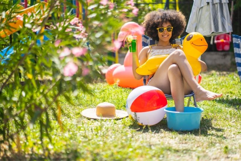 woman having a staycation at her backyard